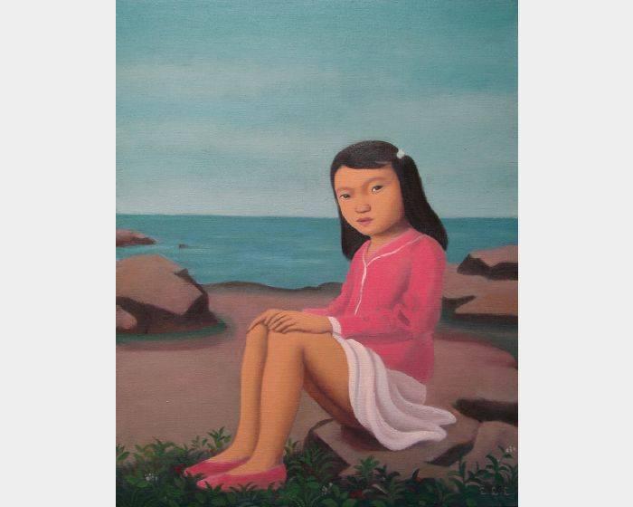 坐海邊的小女孩