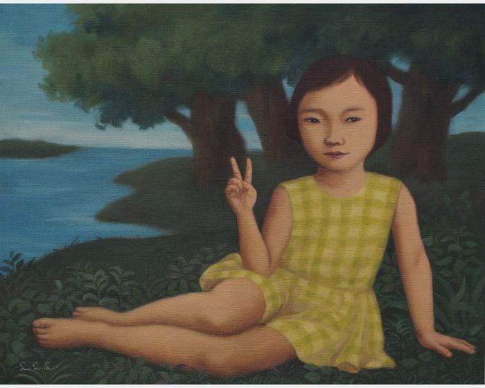 坐在河邊的女孩