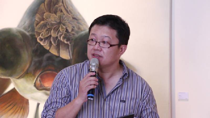 高雄市現代畫學會理事長李錦明。圖/非池中藝術網攝。