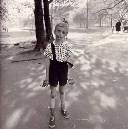 Child with hand grenadedia near bus,1962