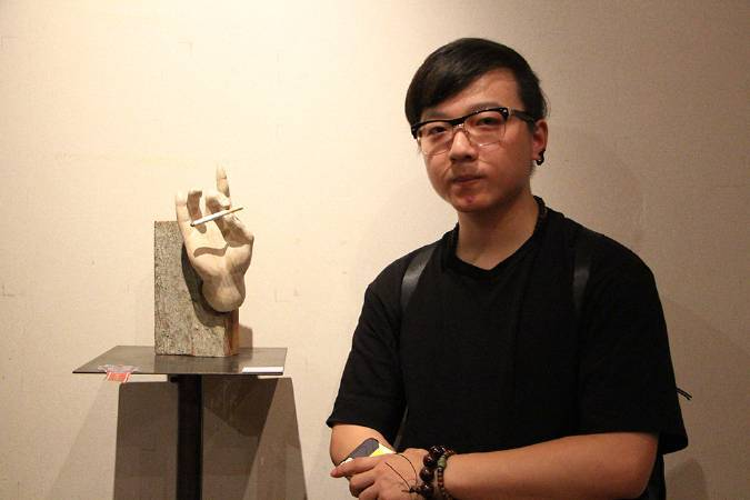 國際袖珍雕塑展金賞,古師承《釋迦五印-煙印》。圖/非池中藝術網攝。