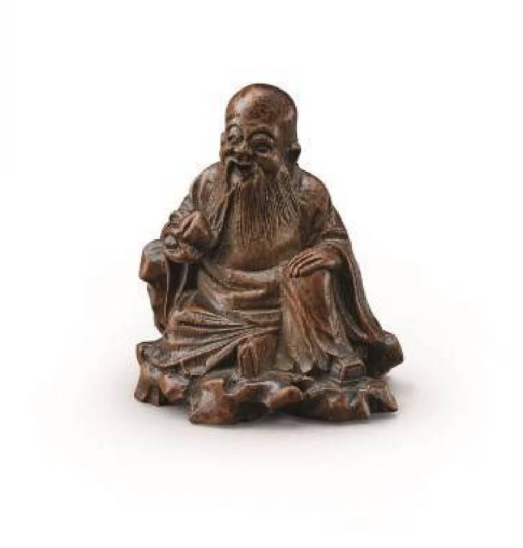 十八世紀〈竹根雕東方朔〉,高7cm,NT$25-40萬